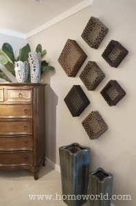 Filling an empty wall with baskets add dimension, texture, and interest.