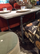 Designer Angelo Surmelis uses reclaimed wood and iron pipes to create a an industrial dining table.