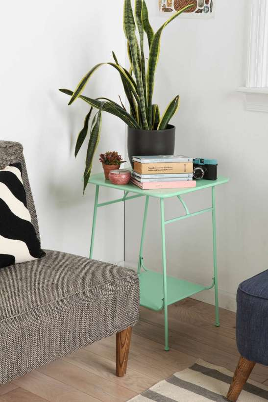 Metal plant stand is up cycled into a chic end table. (source: urban outfitters.com)