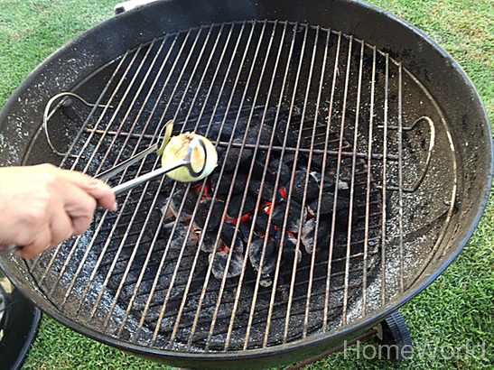 Next, use half of an onion and rub the hot grate. The onion is antibacterial and anti parasitic. This is a good idea especially is you are using a public grill at a park or beach since you don't know what they grilled last.