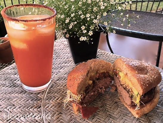 Time to eat! Homemade burgers served with li-hing margarita!