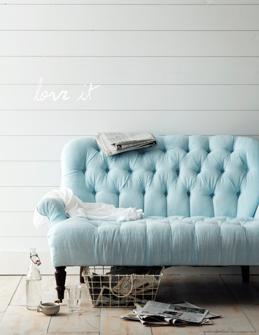 Button-tufted blue loveseat. Source: decor8blog
