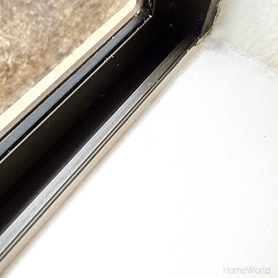 clean window tracks after using mixture of baking soda and vinegar all natural household products for cleaning