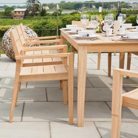 Photo caption: Outdoor table options include solid heartwood in a golden wood grain. Photo credit: Jensen Leisure
