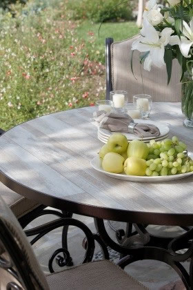 Photo caption: This reclaimed-wood-look table is actually durable porcelain tile. Photo credit: OW Lee