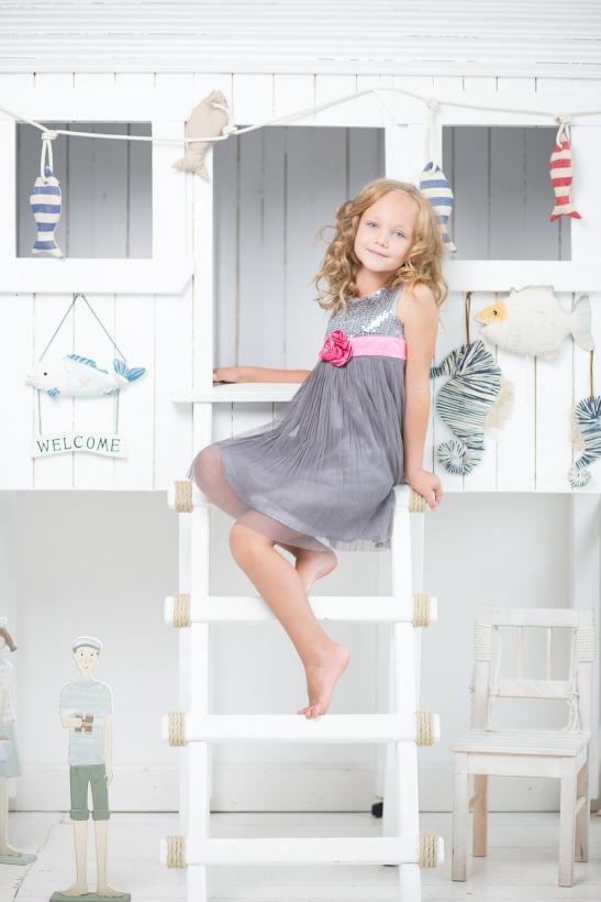 girl on ladder of loft bed